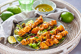 Chicken skewers with sauce