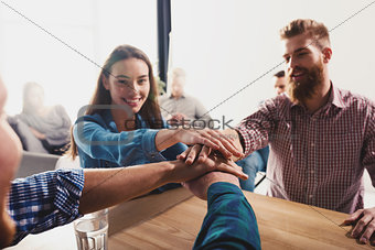 Business people putting their hands together. Concept of teamwork and partnership