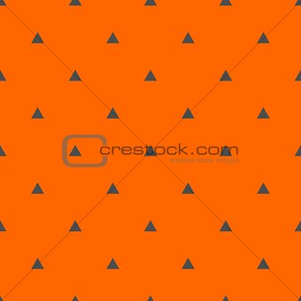 Tile vector pattern with black triangles on orange background