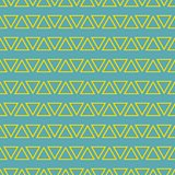Tile vector pattern with yellow triangles on pastel mint green background