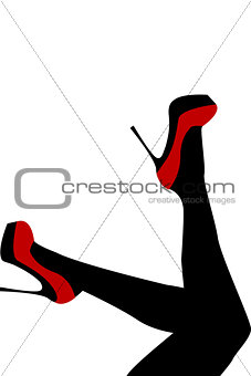 Female legs wearing red shoes with high heels
