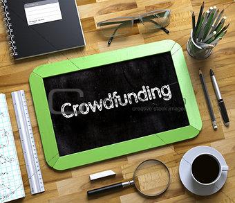 Crowdfunding Handwritten on Small Chalkboard. 3D.