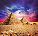 Pyramids and violet clouds
