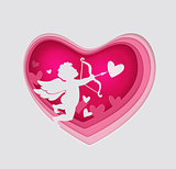 Paper pink heart and cupid