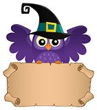 Halloween owl holding small parchment