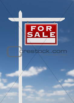 Right Facing For Sale Real Estate Sign on a Blue Sky with Clouds