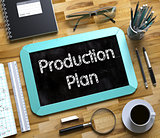Production Plan Handwritten on Small Chalkboard. 3d