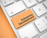 Enterprise Development - Text on Orange Keyboard Keypad. 3D.
