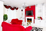 Classical red living room interior with fire place and red furni