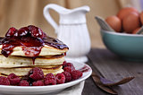 Delicious Pancakes with Fresh Rasperries and Raspberry Sauce