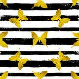 Golden butterflies on a striped background