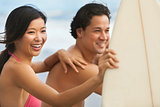 Asian Man Woman Couple Surfboards Surfing on Beach