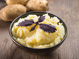 Mashed potatoes on wooden background