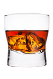 Elegant glass of whiskey with ice cubes