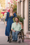 Woman with Braids and Man in Wheelchair