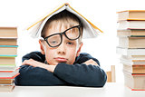 tired schoolboy and piles of books on white background, close-up