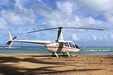 Small helicopter for excursions on a deserted beach