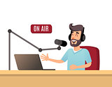 The radio presenter is talking on the air. A young radio DJ in headphones is working on a radio station. Broadcasts flat design vector illustration.