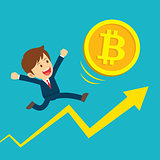 Businessman running on graphs are happy at the bitcoin prices up