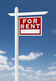 Right Facing For Rent Real Estate Sign on a Blue Sky with Clouds