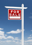 Left Facing For Sale Real Estate Sign on a Blue Sky with Clouds.