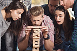 Team of business people build a wooden construction. concept of teamwork ,partnership and company startup
