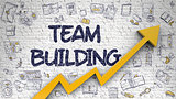 Team Building Drawn on White Brickwall.