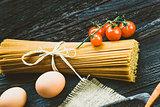 Pasta ingredients on wood