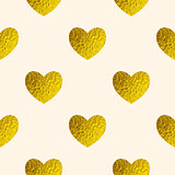 Seamless pattern with golden hearts.