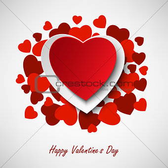 Valentine greeting card with different red hearts in background