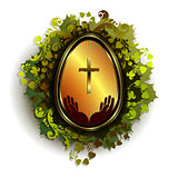 golden Easter egg with a cross and a wreath of leaves