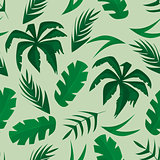 Seamless pattern with tropical leaves on green background