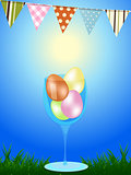 Easter eggs in a glass wn blue background with bunting