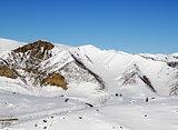 Snowy winter mountains at nice sun morning