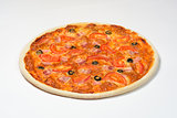 Pizza with tomatoes, ham, cheese and olives on a white sauce on a white background