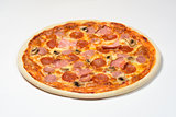 Pizza with Bavarian sausage, cervelat, carbonate, mozzarella cheese on white background