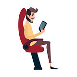 A man is a passenger on a bus or plane. A young man sits in the airplane s chair and looks at the tablet. The bus seat is occupied by the reading man.
