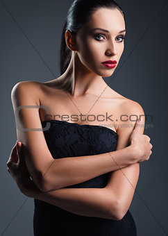 Studio fashion shot: attractive young woman dressed in black