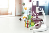 Microscope with lab glassware, flasks and colbas.Science laborat