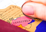 Travel holiday to Venezuela concept with passport