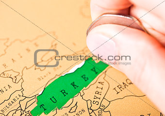Travel holiday to Turkey concept female hand coin