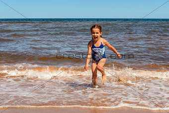 Little girl playing on the Cavendish beach