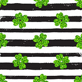 Pattern with black lines and green clover