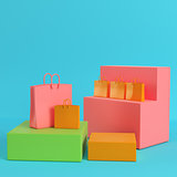 Shopping bags on colorfull boxes on bright blue background in pa