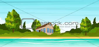 Small house on the river bank. Rural summer landscape