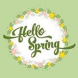 Beautiful greeting card with flowers on a white background and stylized inscription Hello Spring. Spring template for your design, cards, invitations, posters.