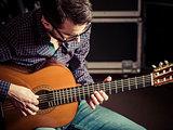 Guitarist playing acoustic guitar