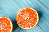 Sliced orange on a blue wooden background