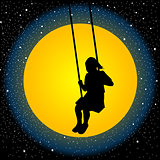 Child having fun on a swing in the night
