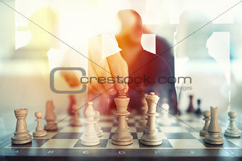 Business tactic with chess game and businessmen that work together in office. Concept of teamwork, partnership and strategy. double exposure